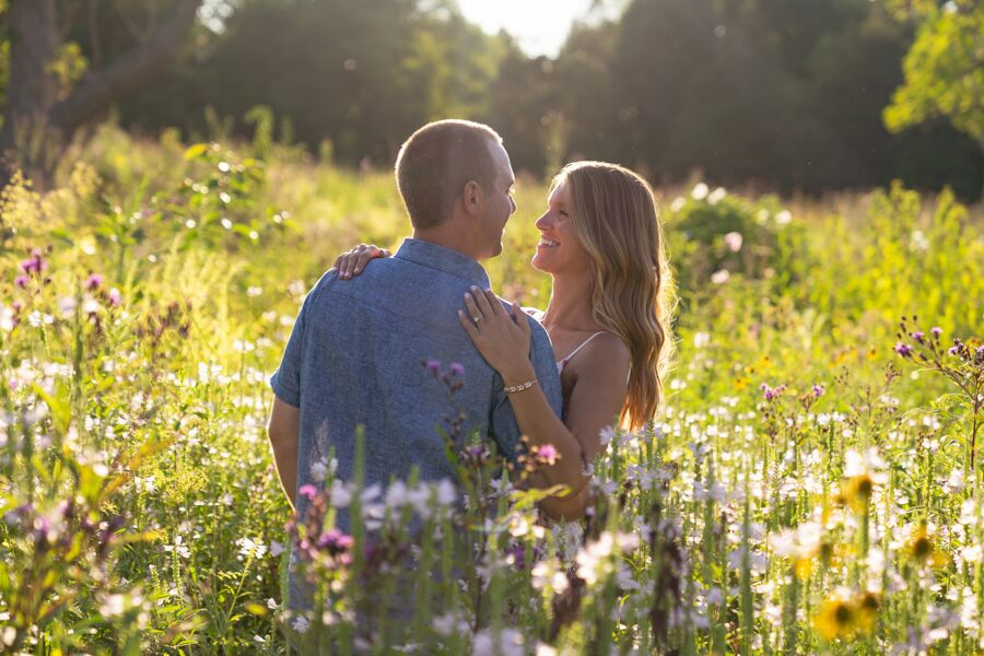 Man and woman hugging in a field of flowers